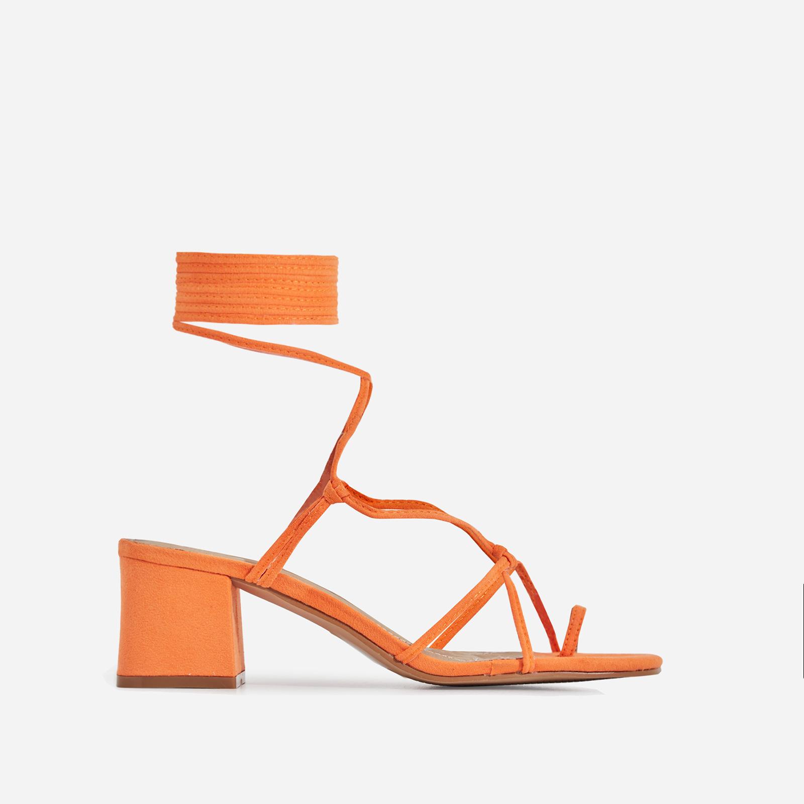 Circe Midi Block Heel Lace Up Heel In Orange Faux Suede