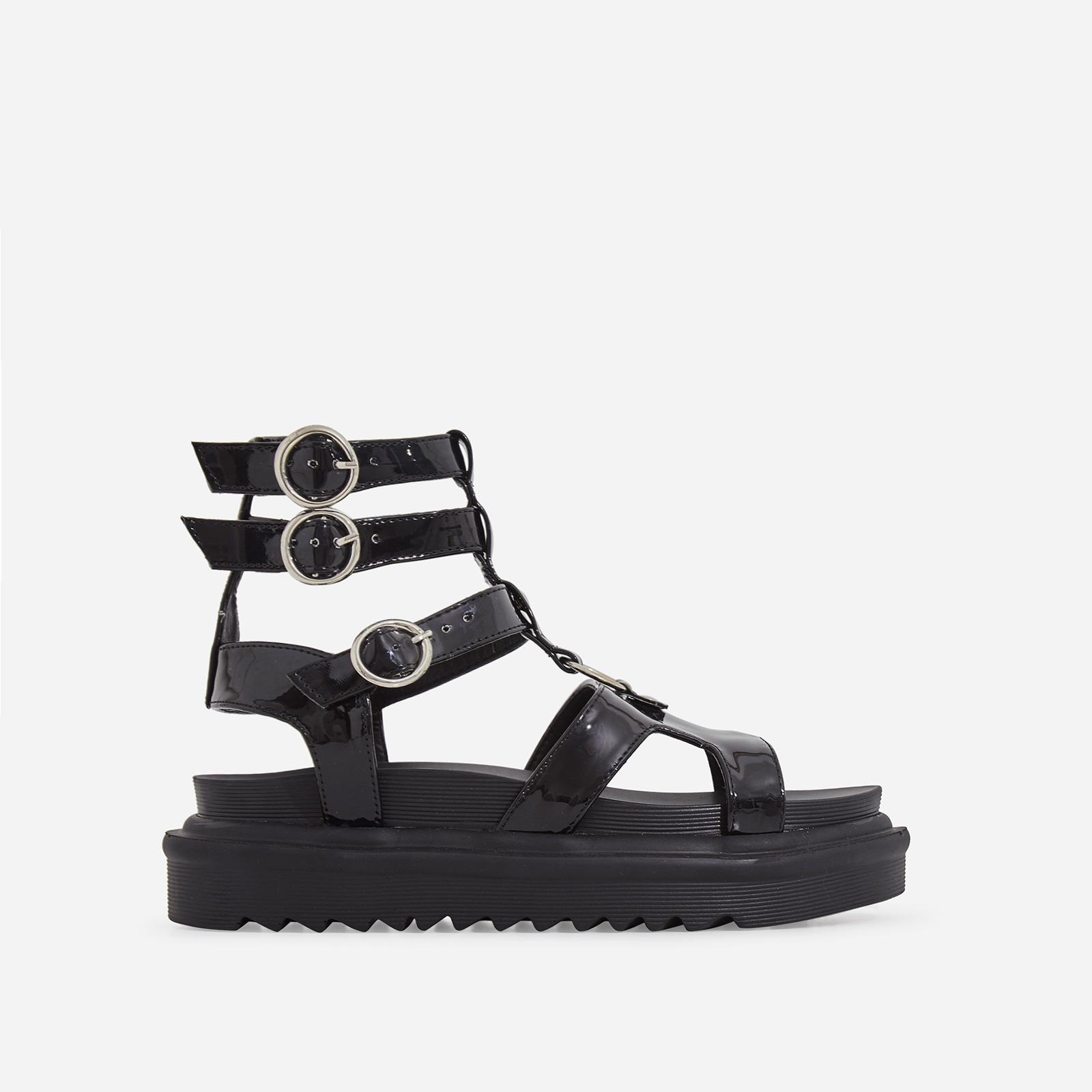 Gladys Chunky Sole Gladiator Sandal In Black Patent