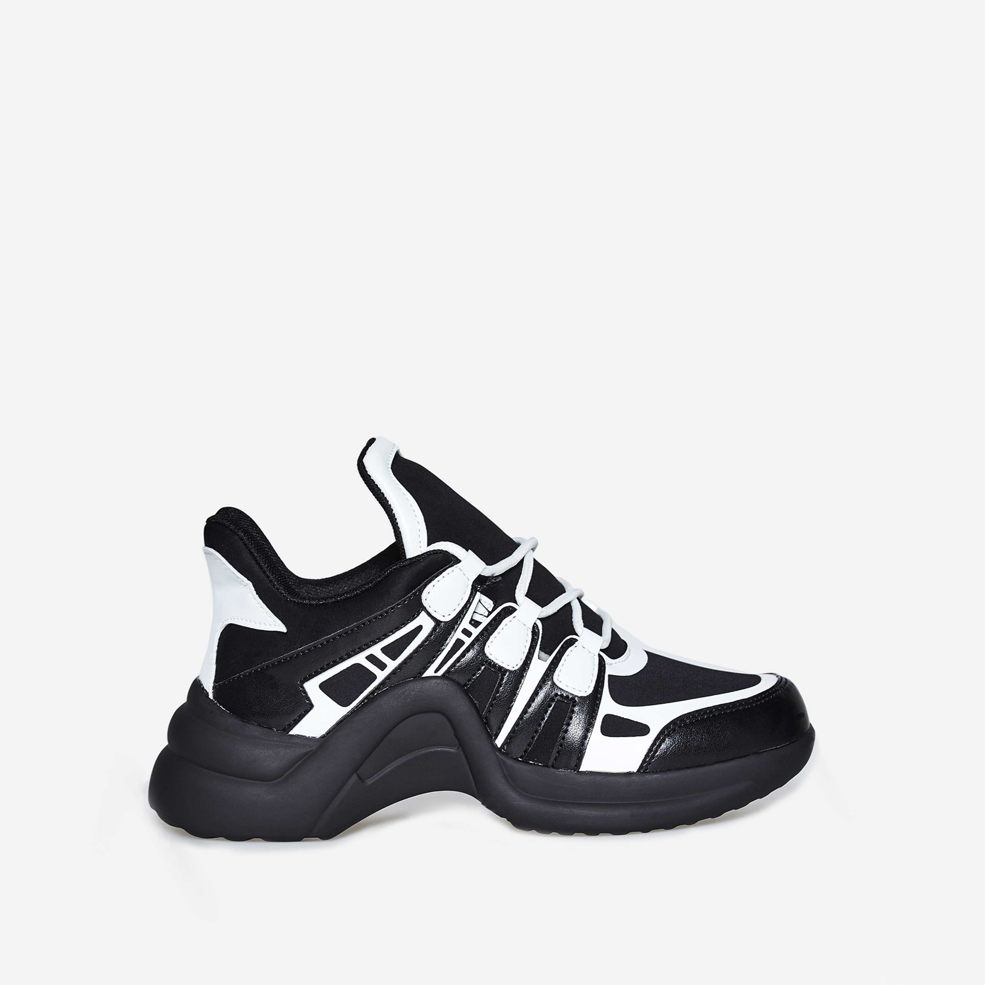 Marisa Wave Sole Trainer In Black And White Faux Leather