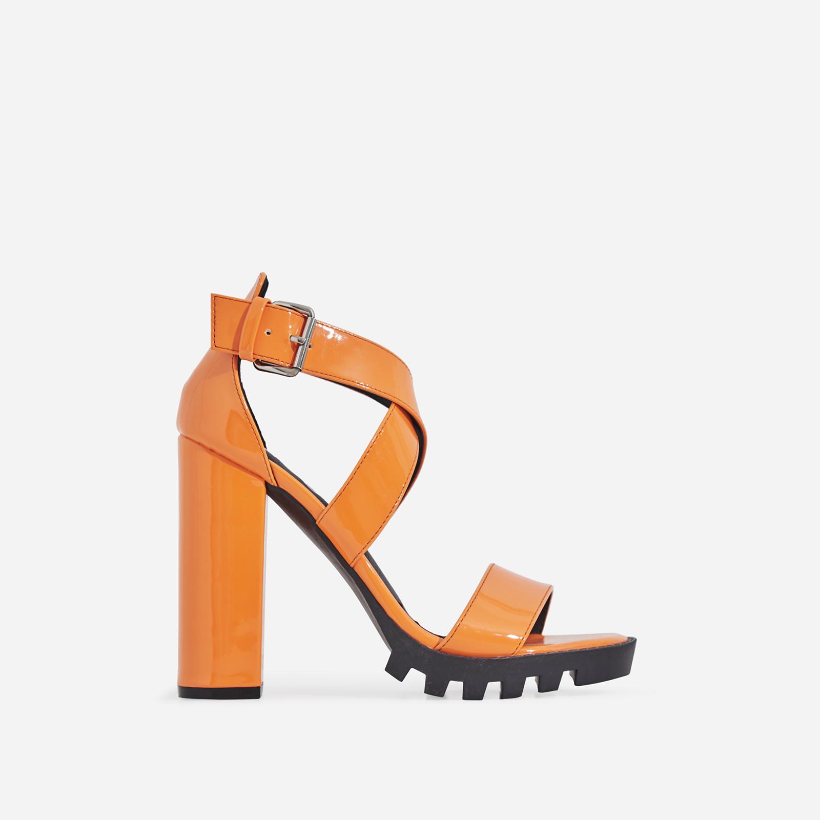 Tori Cleated Sole Block Heel In Orange Patent